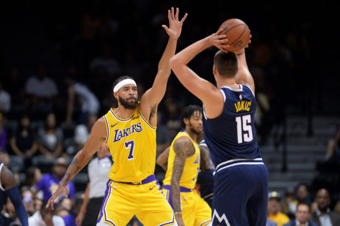 Los Angeles Lakers center JaVale McGee (7) defends Denver Nuggets center Nikola Jokic (15) during the first quarter at Valley View Casino Center.