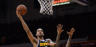 Los Angeles Lakers forward Brandon Ingram (14) draws a foul as Denver Nuggets forward Trey Lyles (7) goes to the basket during the second half at Valley View Casino Center.