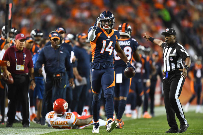 Denver Broncos wide receiver Courtland Sutton (14) signals a first down after making a reception in the second quarter against the Kansas City Chiefs at Broncos Stadium at Mile High.