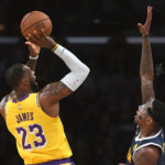 Los Angeles Lakers forward LeBron James (23) makes a shot over Denver Nuggets forward Torrey Craig (3) in the first quarter of the game at Staples Center.