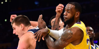 Los Angeles Lakers forward LeBron James (23) battles Denver Nuggets center Nikola Jokic (15) under the basket in the first half at Staples Center.