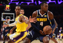 Denver Nuggets forward Paul Millsap (4) dribbles the ball past Los Angeles Lakers guard Rajon Rondo (9) in the first half at Staples Center.