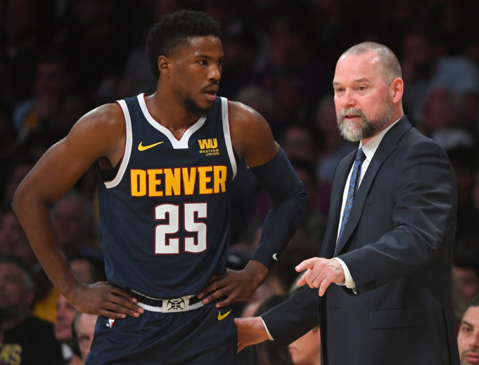 Denver Nuggets guard Malik Beasley (25) talks with head coach Michael Malone (right) in the first half of the game against the Los Angeles Lakers at Staples Center.