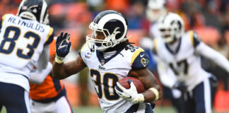 Los Angeles Rams running back Todd Gurley II (30) carries the ball in the fourth quarter against the Denver Broncos at Broncos Stadium at Mile High.