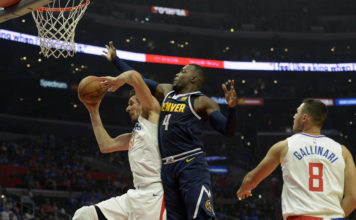 Oct 17, 2018; Los Angeles, CA, USA; LA Clippers center Boban Marjanovic (51) grabs a rebound against Denver Nuggets forward Paul Millsap (4) during the second quarter at Staples Center. Mandatory Credit: Jake Roth-USA TODAY Sports
