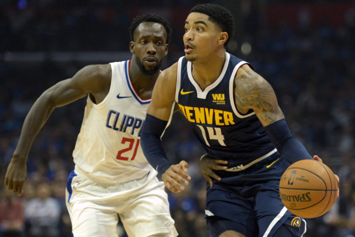 Denver Nuggets guard Gary Harris (14) dribbles against LA Clippers guard Patrick Beverley (21) during the second quarter at Staples Center.