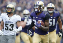 Oct 20, 2018; Seattle, WA, USA; Washington Huskies running back Kamari Pleasant (24) runs for a touchdown ahead of Colorado Buffaloes linebacker Nate Landman (53) during the second quarter at Husky Stadium. Mandatory Credit: Jennifer Buchanan-USA TODAY Sports