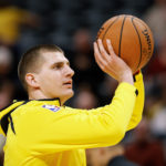 Denver Nuggets center Nikola Jokic (15) warms up before the game against the Phoenix Suns at the Pepsi Center.