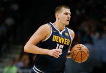 Denver Nuggets center Nikola Jokic (15) dribbles the ball up court in the first quarter against the Phoenix Suns at the Pepsi Center.