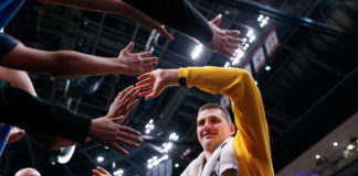 Denver Nuggets center Nikola Jokic (15) greets fans after the game against the Phoenix Suns at the Pepsi Center.