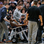 Denver Nuggets guard Will Barton (5) is carted off the court in the third quarter against the Phoenix Suns at the Pepsi Center.