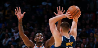 Phoenix Suns center Deandre Ayton (22) defends against Denver Nuggets center Nikola Jokic (15) in the fourth quarter at the Pepsi Center.