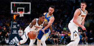 Oct 21, 2018; Denver, CO, USA; Golden State Warriors guard Stephen Curry (30) fouls Denver Nuggets guard Monte Morris (11) as center Nikola Jokic (15) defends in the second quarter at the Pepsi Center. Mandatory Credit: Isaiah J. Downing-USA TODAY Sports
