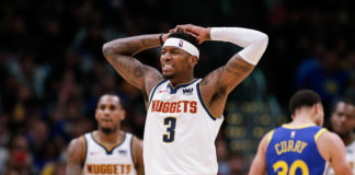 Denver Nuggets forward Torrey Craig (3) reacts after a play in the second quarter against the Golden State Warriors at the Pepsi Center.