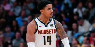 Denver Nuggets guard Gary Harris (14) reacts after a play in the fourth quarter against the Golden State Warriors at the Pepsi Center.