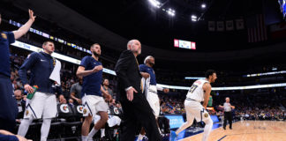 Denver Nuggets head coach Michael Malone (center) and players react to a defensive play in the fourth quarter against the Sacramento Kings at Pepsi Center.