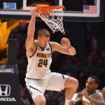 Denver Nuggets forward Mason Plumlee (24) finishes off a dunk in the second half against the Sacramento Kings at the Pepsi Center.