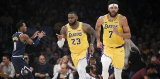 Los Angeles Lakers forward LeBron James (23) reacts after a shot during the first half against the Denver Nuggets at Staples Center.