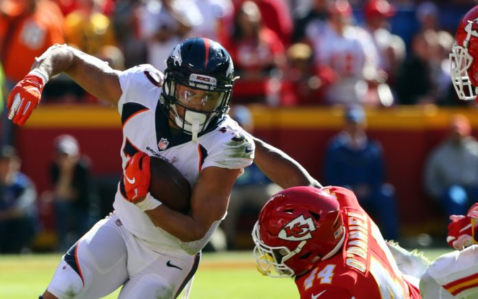 Phillip Lindsay runs out of a tackle. Credit: Jay Biggerstaff, USA TODAY Sports.