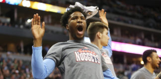 Denver Nuggets guard Malik Beasley (25) reacts from the bench during the second half against the Detroit Pistons at Pepsi Center. The Pistons won 106-95.