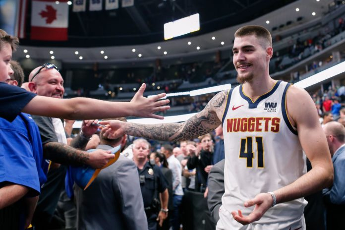Denver Nuggets forward Juancho Hernangomez (41) greets fans after the game against the Golden State Warriors at the Pepsi Center.
