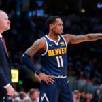 Denver Nuggets guard Monte Morris (11) talks with head coach Michael Malone in the third quarter against the New Orleans Pelicans at the Pepsi Center.