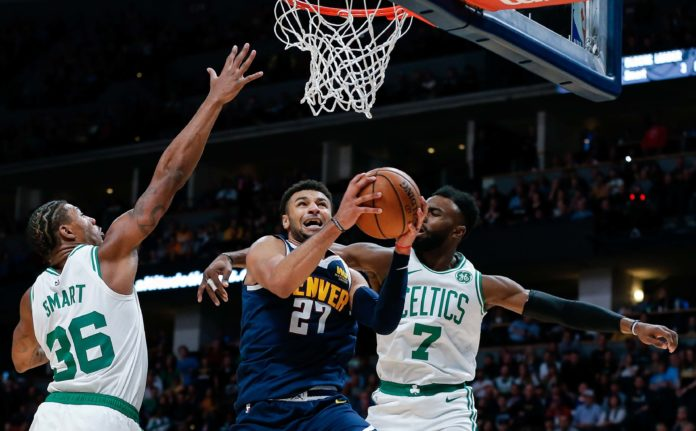 Boston Celtics guard Marcus Smart (36) and guard Jaylen Brown (7) defend against Denver Nuggets guard Jamal Murray (27) in the fourth quarter at Pepsi Center.