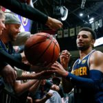 Denver Nuggets guard Jamal Murray (27) signs autographs after the game against the Boston Celtics at Pepsi Center
