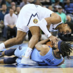 Nov 7, 2018; Memphis, TN, USA; Memphis Grizzlies guard Mike Conley (11) battles for the ball with Denver Nuggets guard Gary Harris (14) at FedExForum. Mandatory Credit: Nelson Chenault-USA TODAY Sports