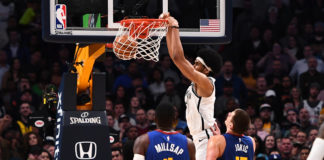 Nov 9, 2018; Denver, CO, USA; Brooklyn Nets center Jarrett Allen (31) dunks the ball in the fourth quarter against the Denver Nuggets at the Pepsi Center. Mandatory Credit: Ron Chenoy-USA TODAY Sports