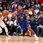 Denver Nuggets guard Gary Harris (14) drives to the basket in the second half against the Denver Nuggets at the Pepsi Center.