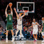Denver Nuggets forward Mason Plumlee (24) defends on a shot from Milwaukee Bucks center Brook Lopez (11) as forward Trey Lyles (7) and forward Giannis Antetokounmpo (34) battle for position in the fourth quarter at the Pepsi Center.