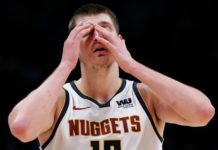 Denver Nuggets center Nikola Jokic (15) reacts in the fourth quarter against the Milwaukee Bucks at the Pepsi Center.