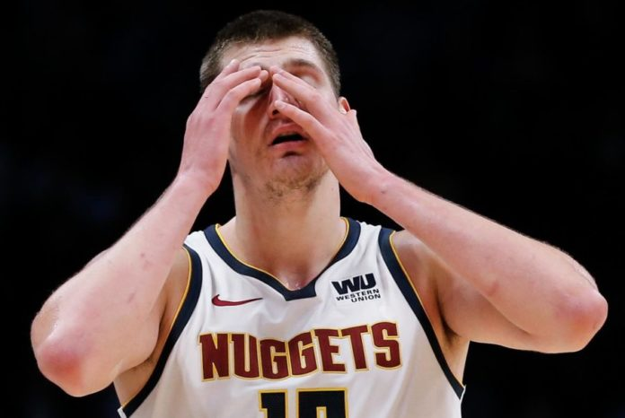 Denver Nuggets center Nikola Jokic (15) reacts in the fourth quarter  against the Milwaukee