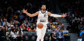 Denver Nuggets guard Jamal Murray (27) motions as he brings the ball up court in the first quarter against the Houston Rockets at the Pepsi Center