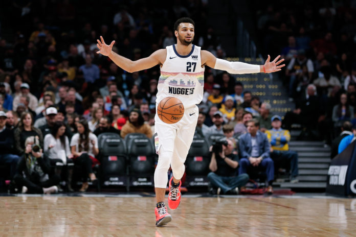 6c701b68d Denver Nuggets guard Jamal Murray (27) motions as he brings the ball up  court