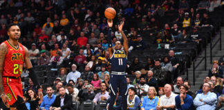 Denver Nuggets guard Monte Morris (11) shoots in the first quarter against the Atlanta Hawks at the Pepsi Center.