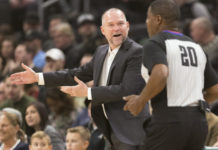 Denver Nuggets head coach Michael Malone argues a call with official Leroy Richardson (20) during the first quarter against the Milwaukee Bucks at Wisconsin Entertainment and Sports Center.