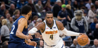 Denver Nuggets forward Paul Millsap (4) dribbles in the first quarter against Minnesota Timberwolves center Karl-Anthony Towns (32) at Target Center.