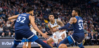 Denver Nuggets guard Gary Harris (14) passes in the second quarter against Minnesota Timberwolves center Karl-Anthony Towns (32) and forward Robert Covington (33) at Target Center.