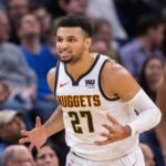 Denver Nuggets guard Jamal Murray (27) celebrates his basket in the third quarter against Minnesota Timberwolves at Target Center.