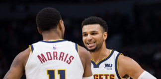 Denver Nuggets guard Jamal Murray (27) celebrates with guard Monte Morris (11) in the third quarter against Minnesota Timberwolves at Target Center.