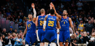 Denver Nuggets guard Jamal Murray (27) and forward Mason Plumlee (24) and guard Malik Beasley (25) and forward Trey Lyles (7) celebrate after a play in the fourth quarter against the Orlando Magic at the Pepsi Center.