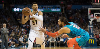 Denver Nuggets guard Jamal Murray (27) looks to pass the ball while defended by Oklahoma City Thunder center Steven Adams (12) during the second quarter at Chesapeake Energy Arena.