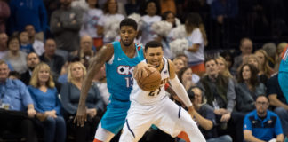 Denver Nuggets guard Jamal Murray (27) fouled by Oklahoma City Thunder forward Paul George (13) during the fourth quarter at Chesapeake Energy Arena.