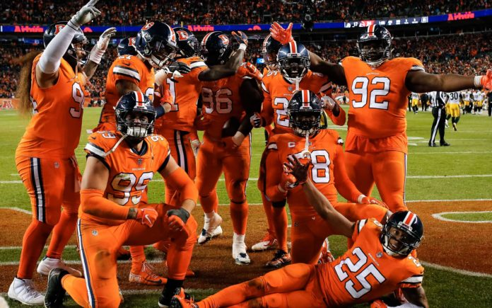 Broncos defense celebrates Shelby Harris' interception to win the game. Credit: Isaiah J. Downing, USA TODAY Sports.