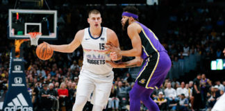 Los Angeles Lakers center JaVale McGee (7) guards Denver Nuggets center Nikola Jokic (15) in the first quarter at the Pepsi Center.