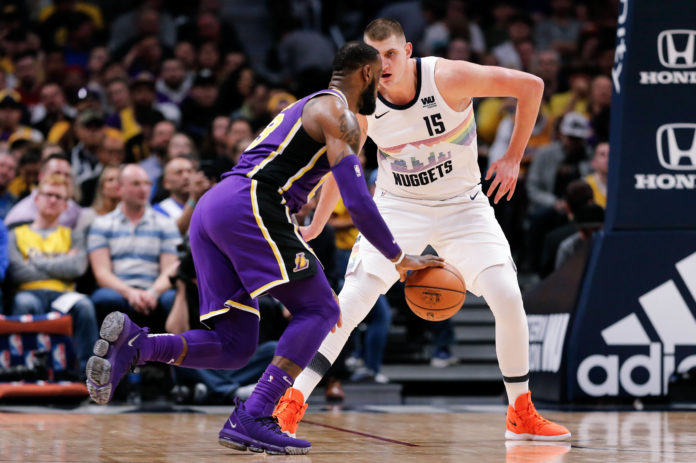 Denver Nuggets center Nikola Jokic (15) guards Los Angeles Lakers forward LeBron James (23) in the second quarter at the Pepsi Center.