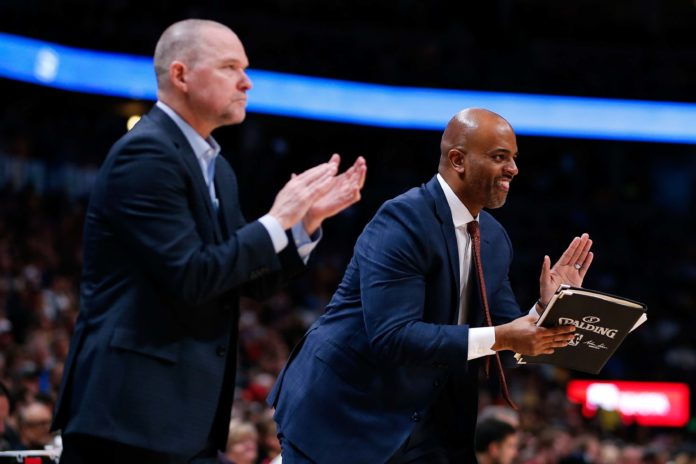 Denver Nuggets assistant coach Wes Unseld Jr. (R) and head coach Michael Malone react after a play in the fourth quarter against the Los Angeles Lakers at the Pepsi Center.