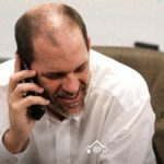 "Mike Bobo on the phone with recruits from the Rams ""War Room"" on Wednesday. Credit: Colorado State Athletics."